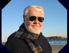 photo of author on beach wearing sunglasses